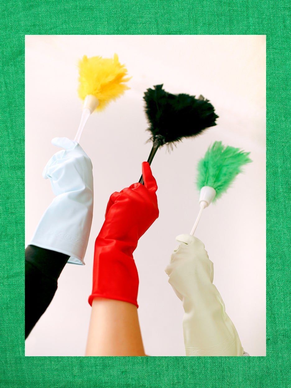 Hands with gloves holding feather dusters