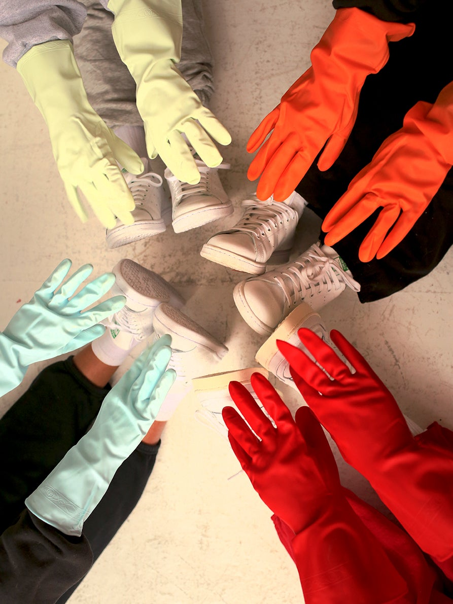 Hands wearing cleaning gloves
