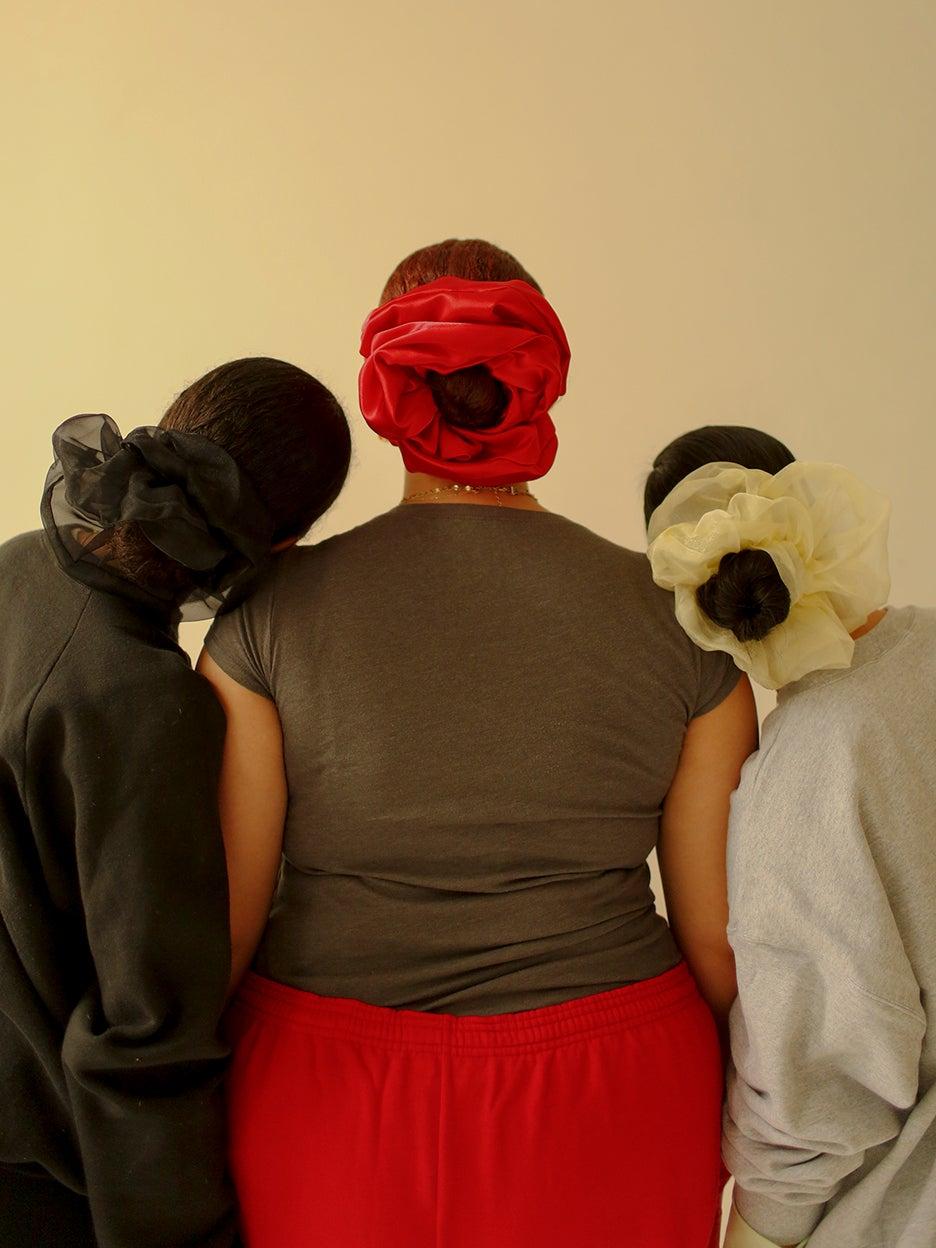 Backs of three women