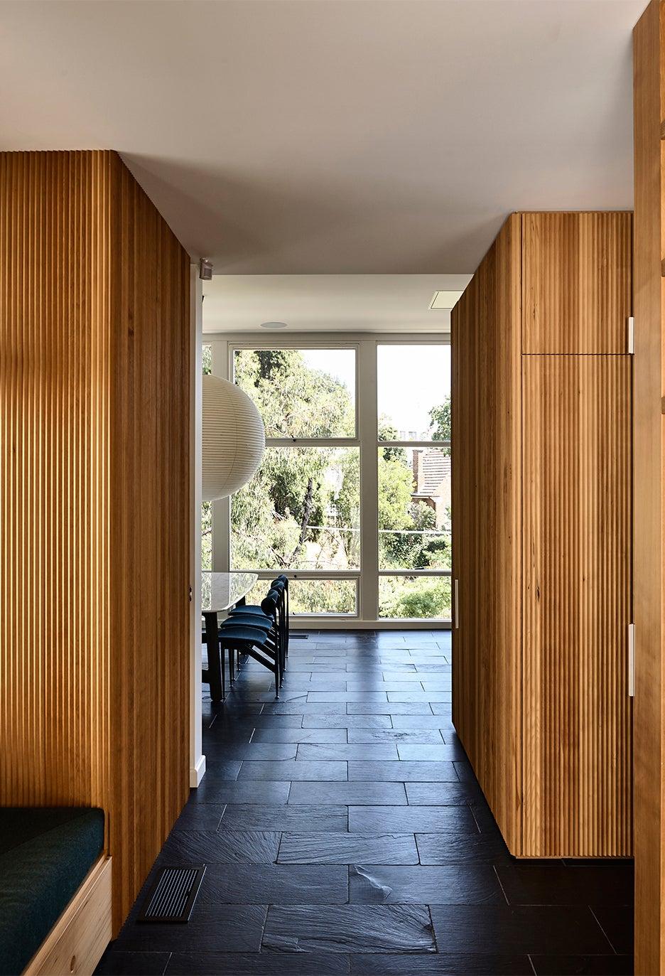 kithcen with wood paneled walls