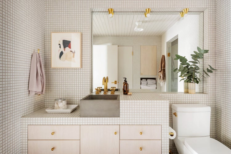 small white tile grids on wall in bathroom