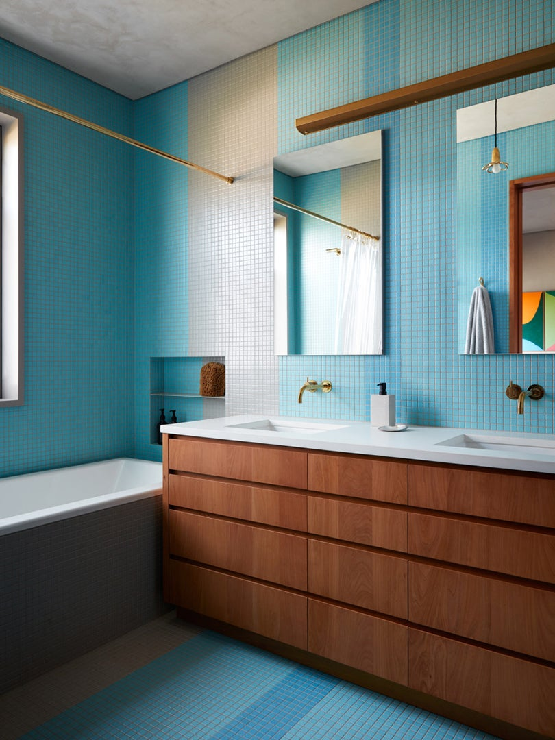 blue tile wall in bathroom with wood fixtures