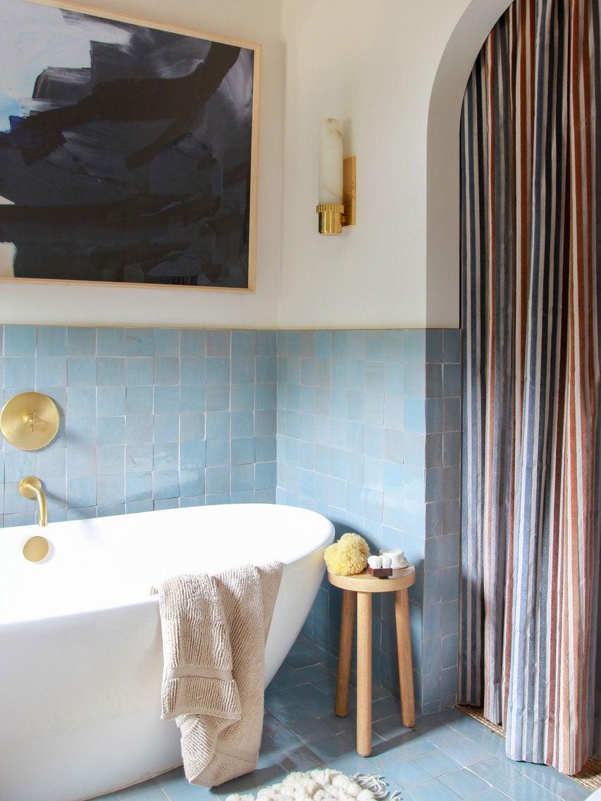 blue zellige tile bathroom with standalone tub