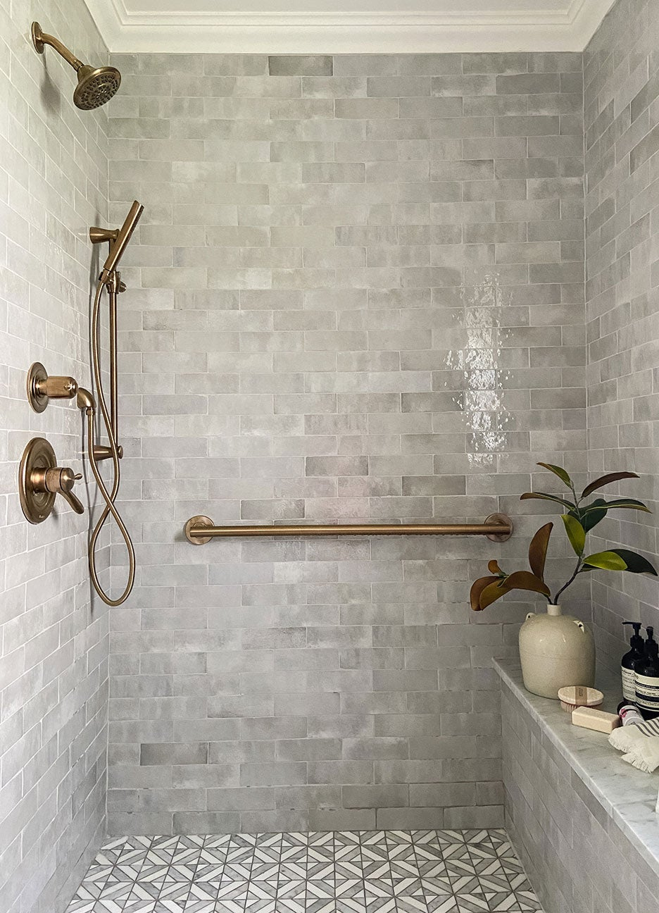 grey shower nook with marble tile