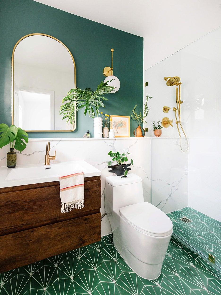 green bathroom with wood sink vanity