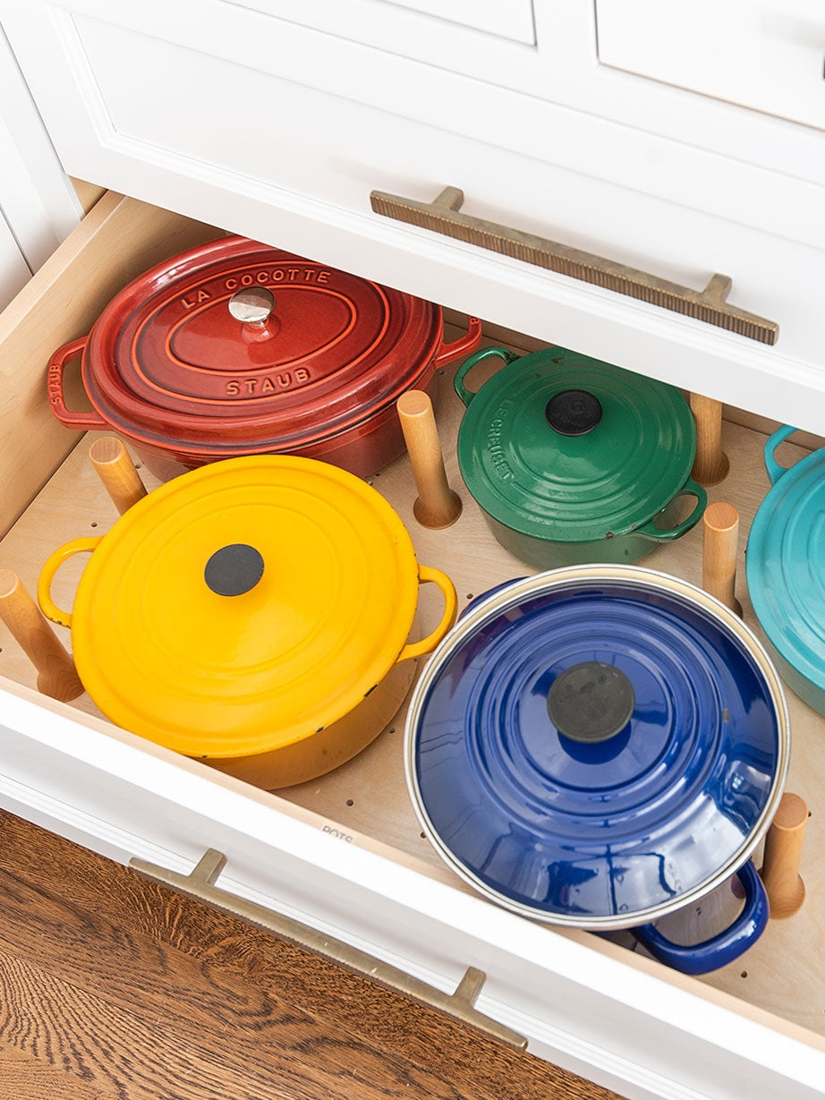Colorful Dutch ovens in drawer