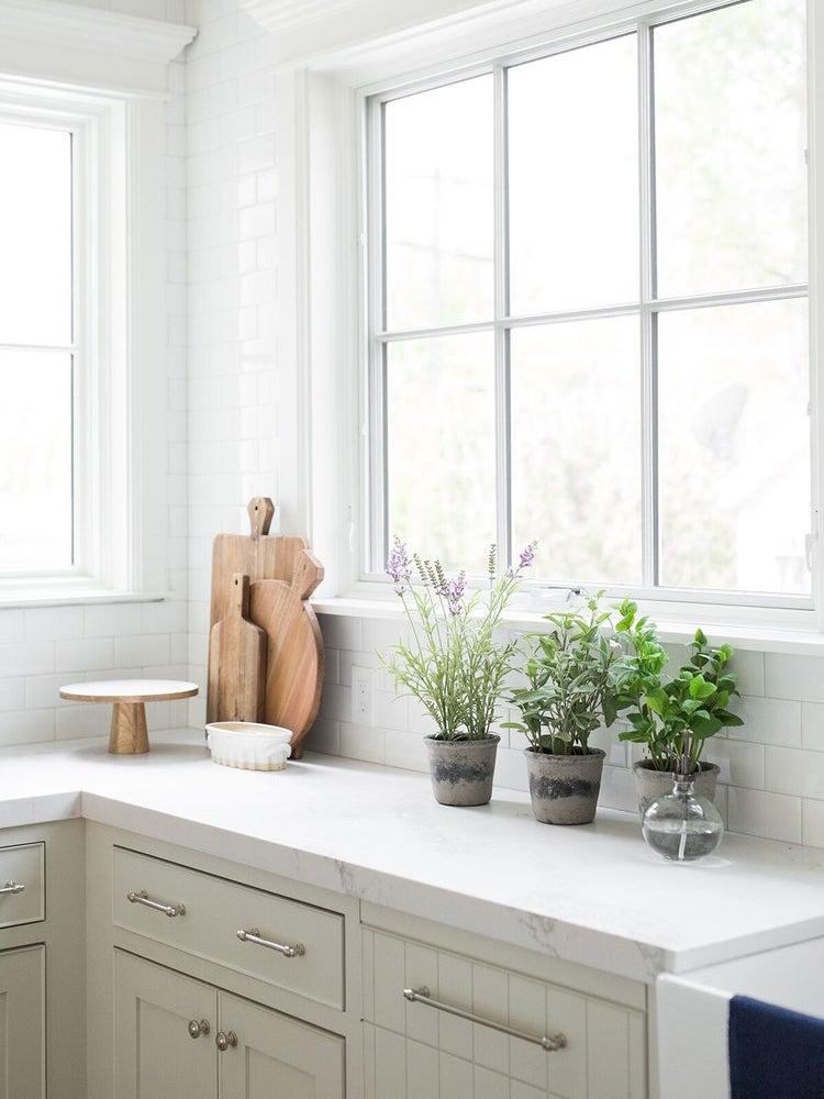 grey kitchen cabinets in all white kitchen