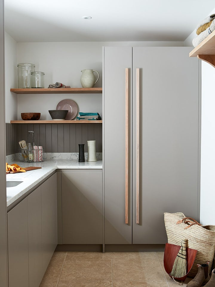 modern grey kitchen with wood open shelving