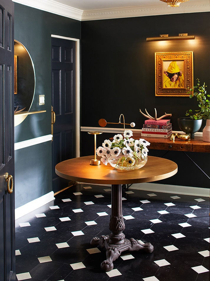dark blue foyer with black and white checkerboard tiles