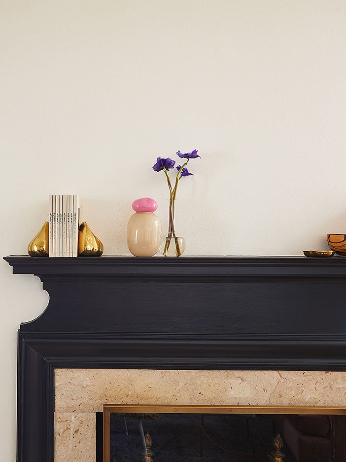 black mantel with vases and bookends