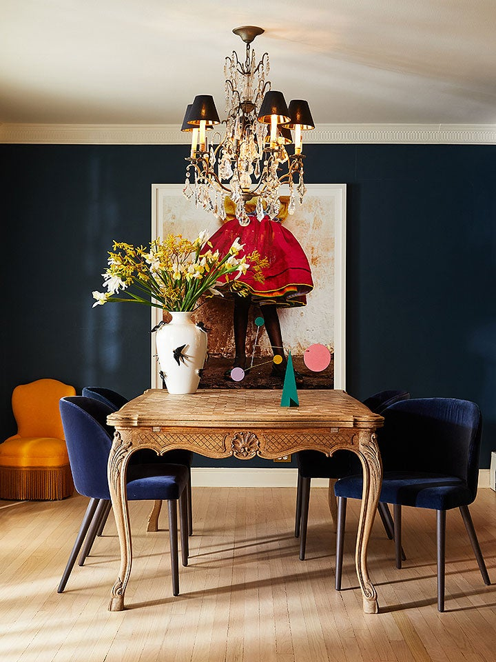 dark blue dining room with wooden table