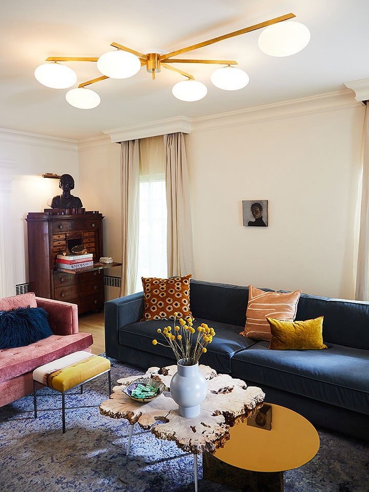 living room with blue couch and antique light fixture