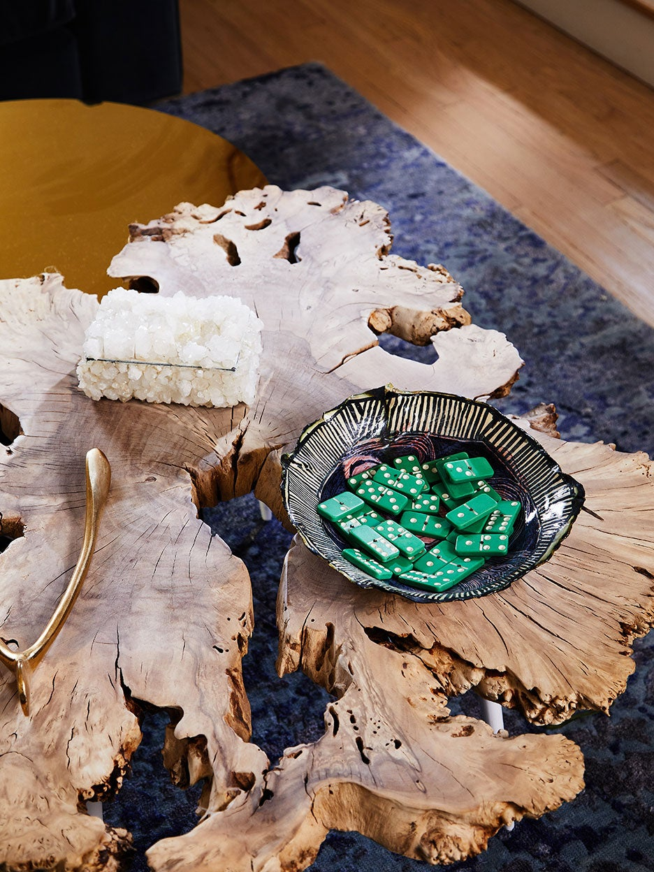 wood coffee table with bowl of dominoes