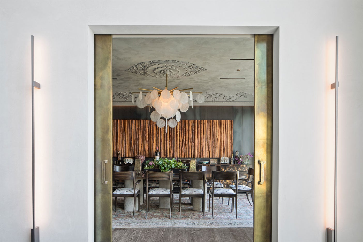 brass doors leading to dining room