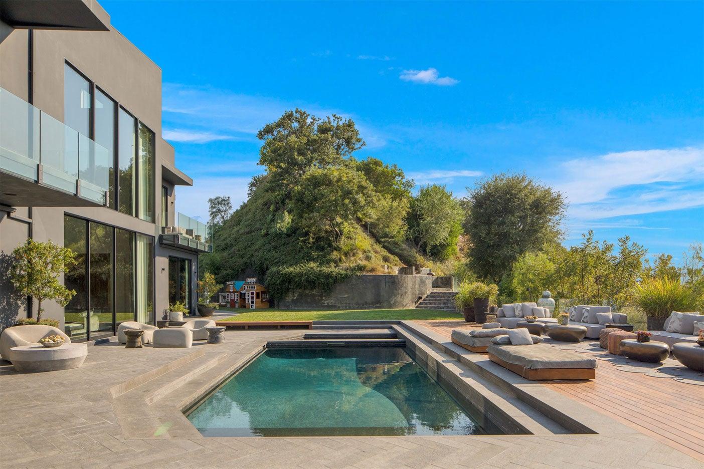 dark exterior with pool