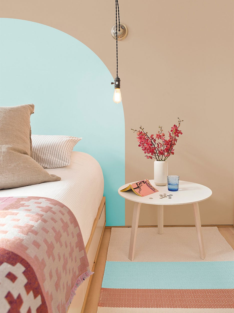 beige bedroom with turquoise mural
