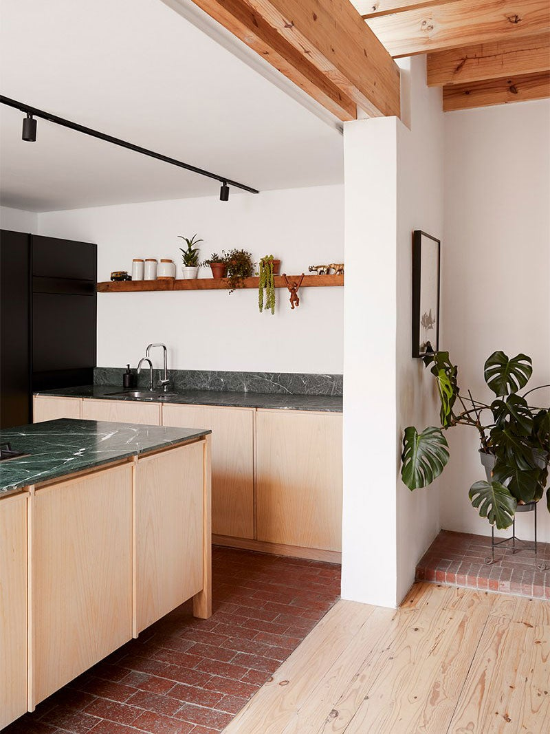 wood kitchen cabinets with green counters