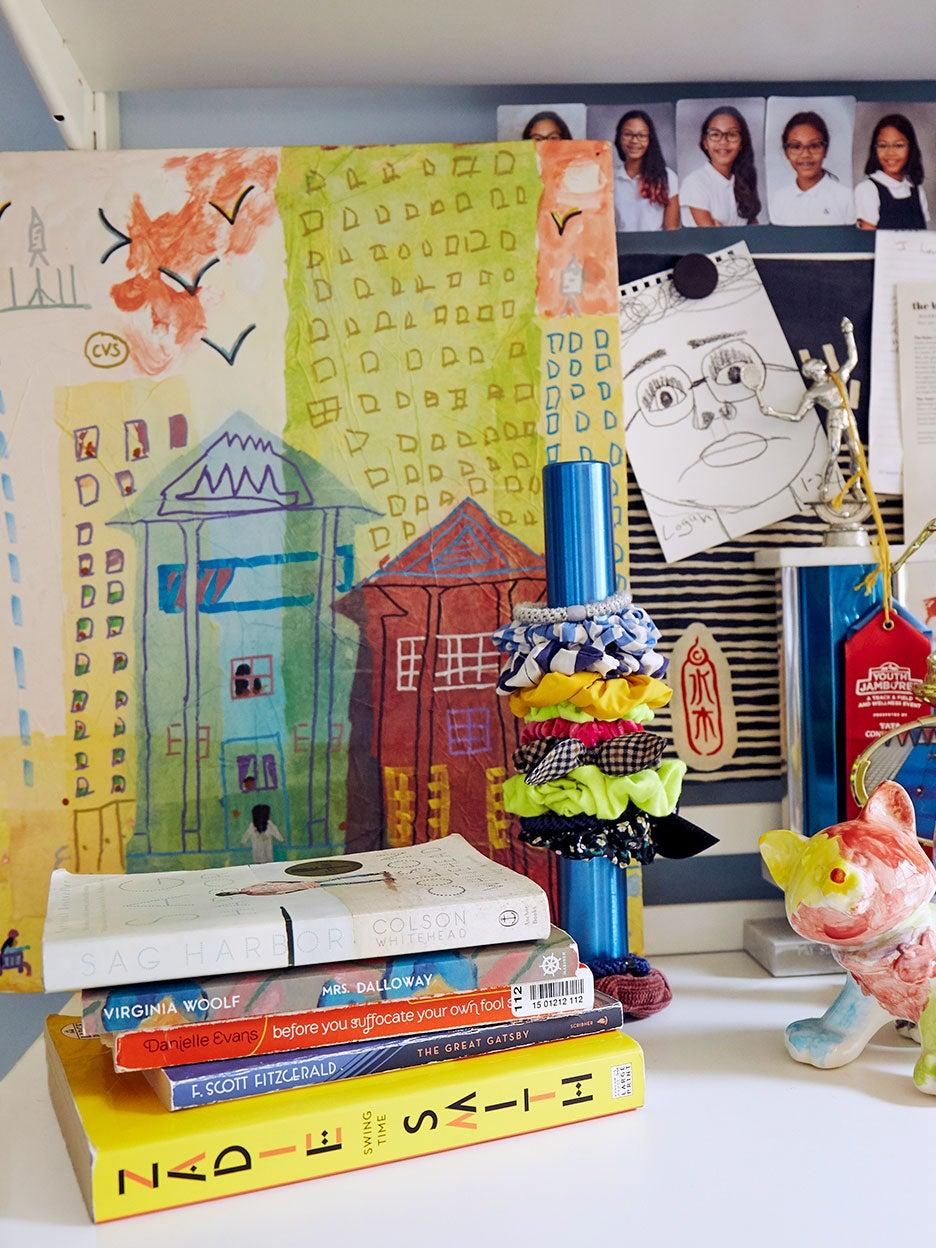 Corner of desk with books