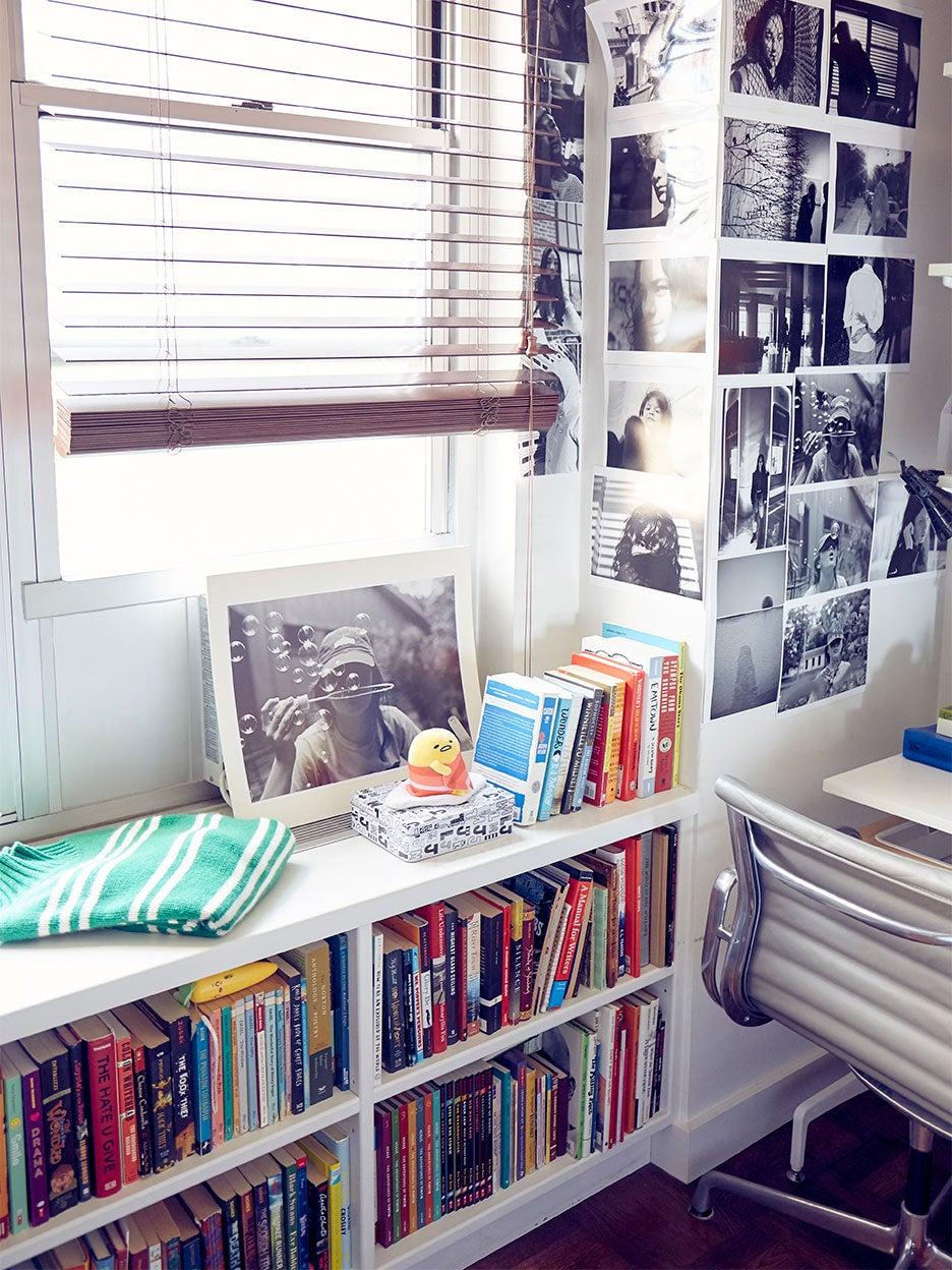Corner of bedroom with bookshelves