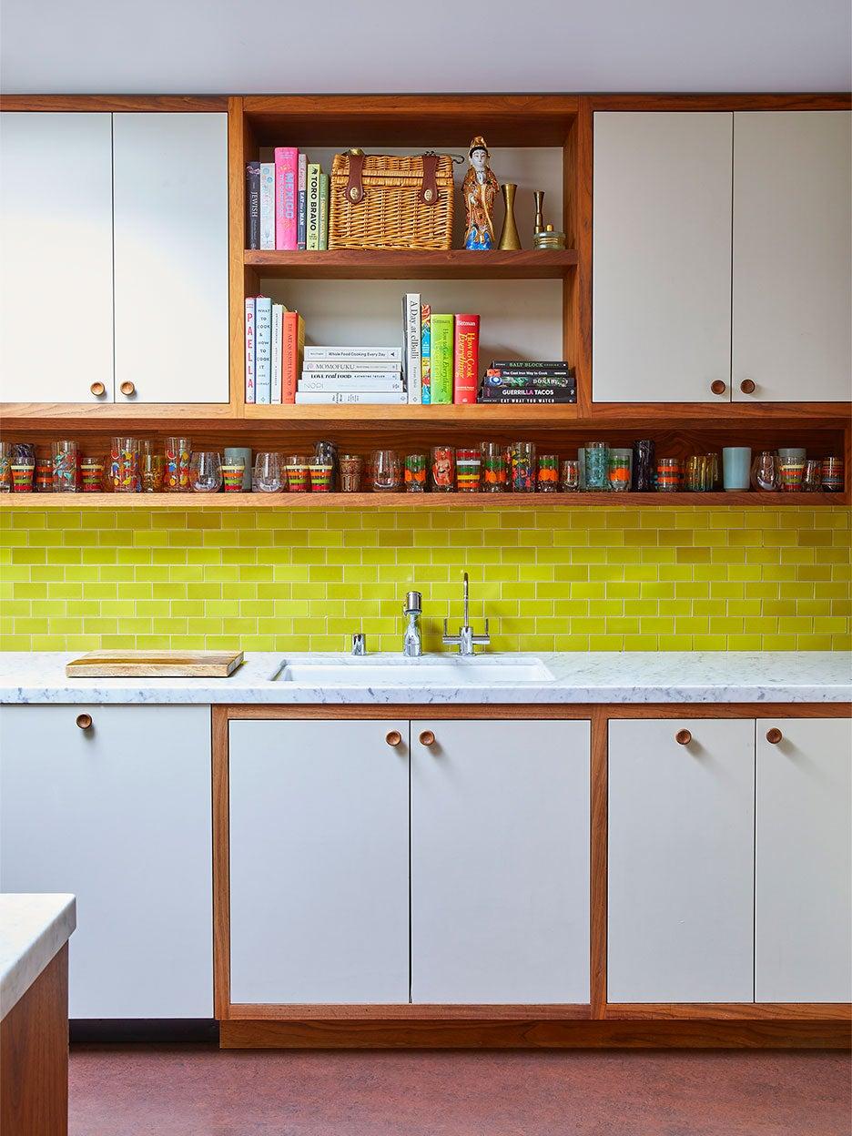Kitchen with neon backsplash