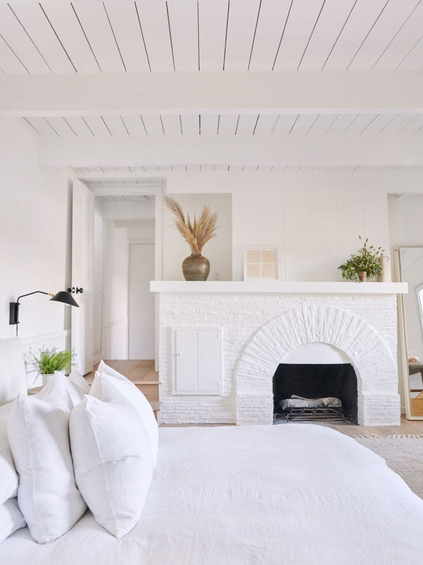 white bedroom fireplace