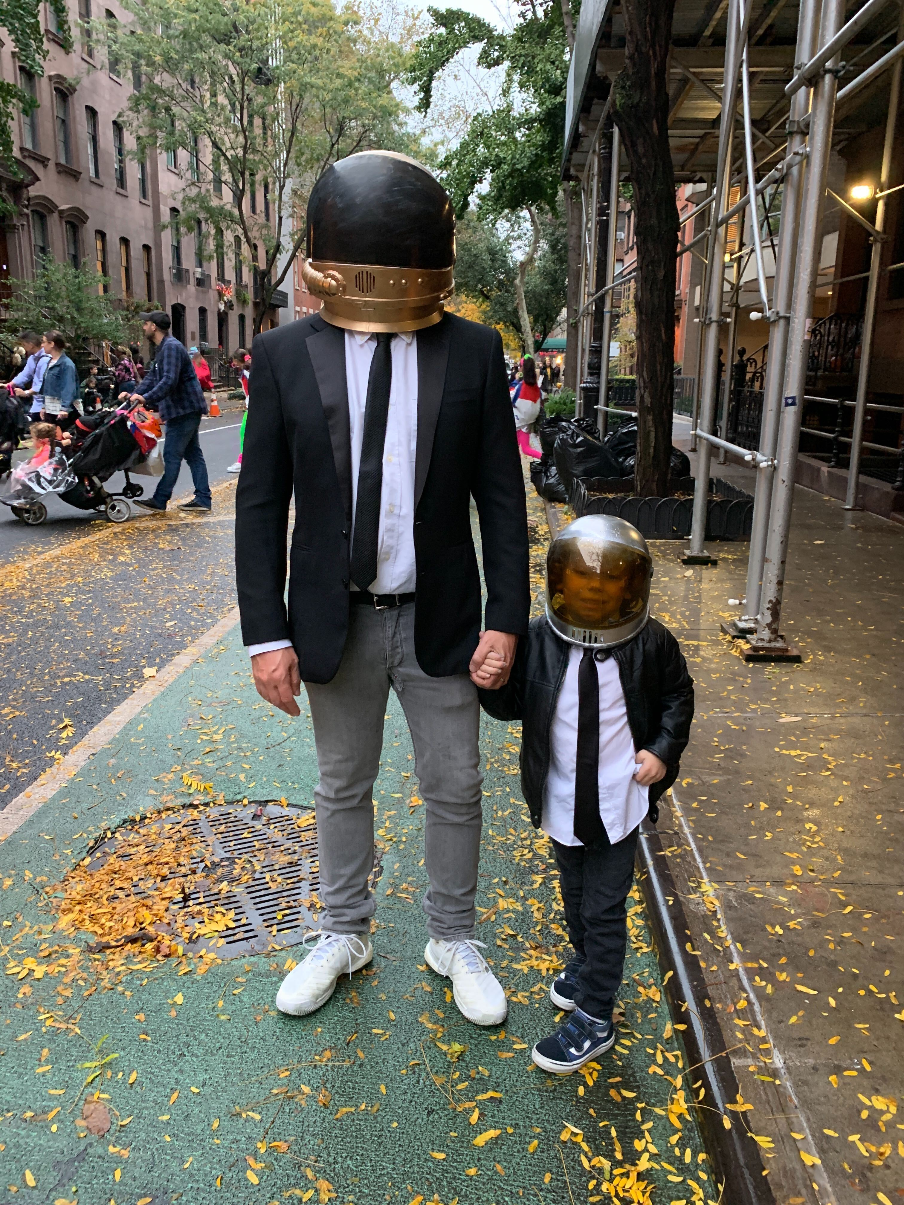 father and son in daft punk outfit