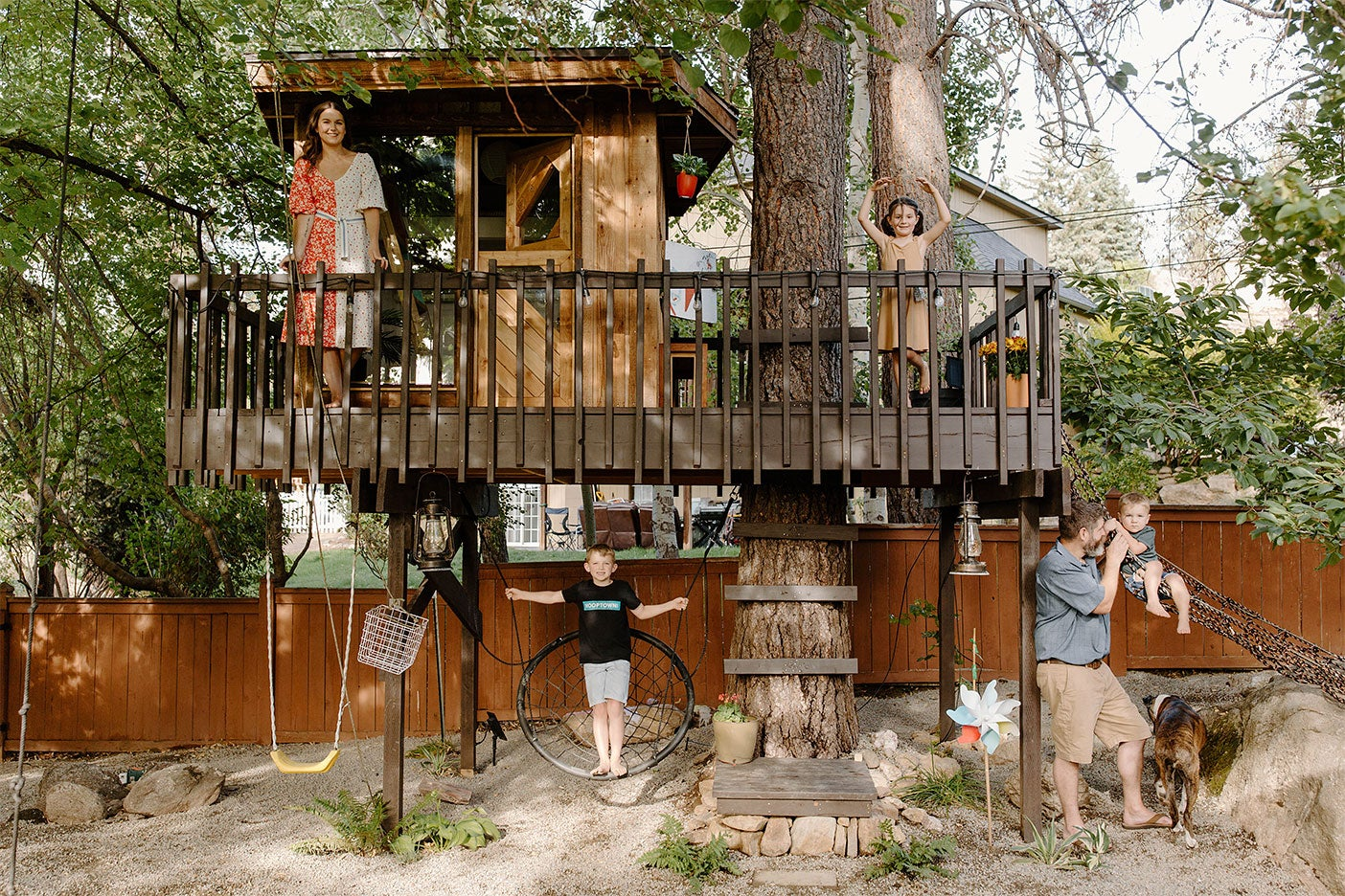brown treeehouse with deck