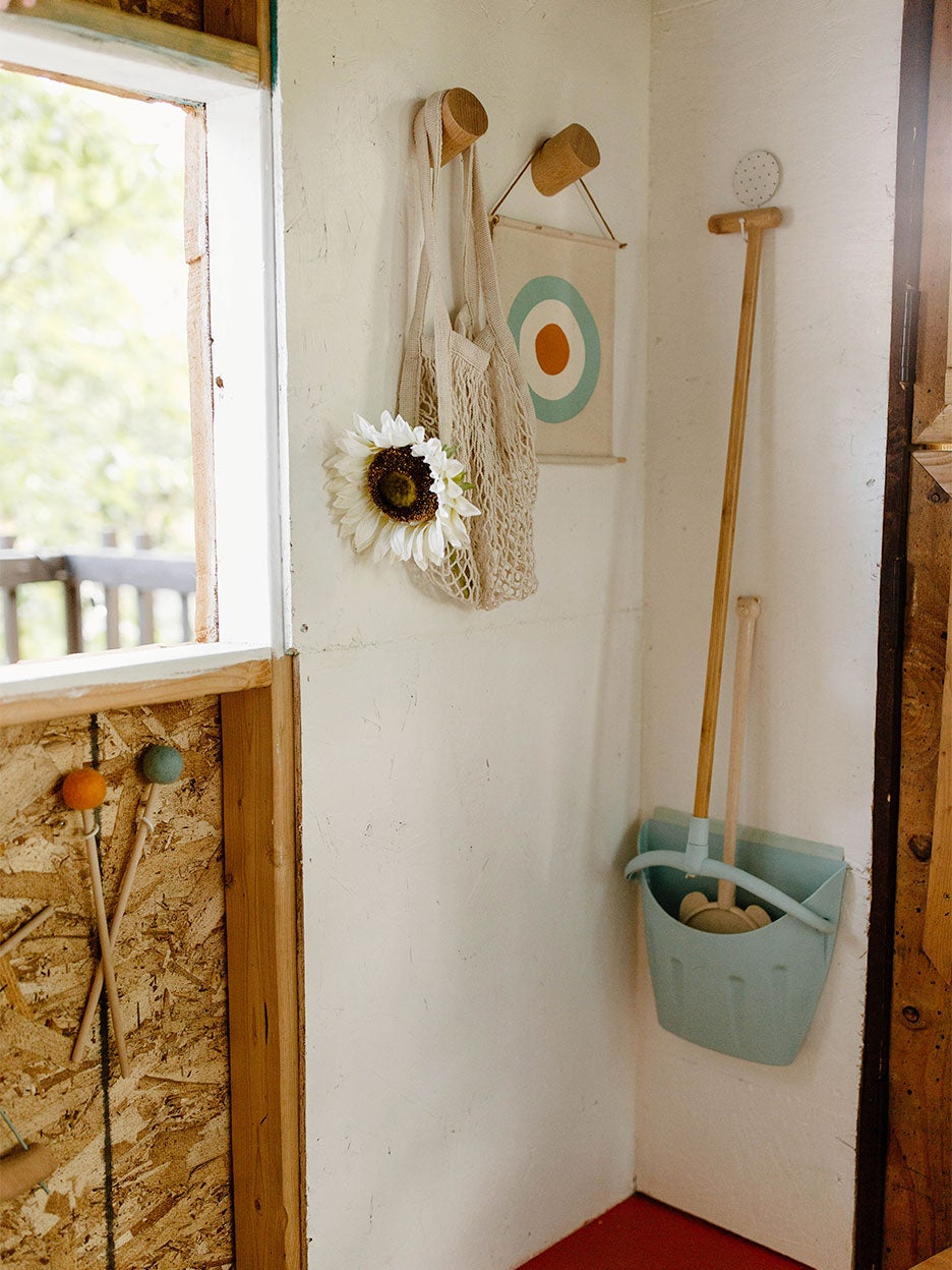 broom hangign on wall