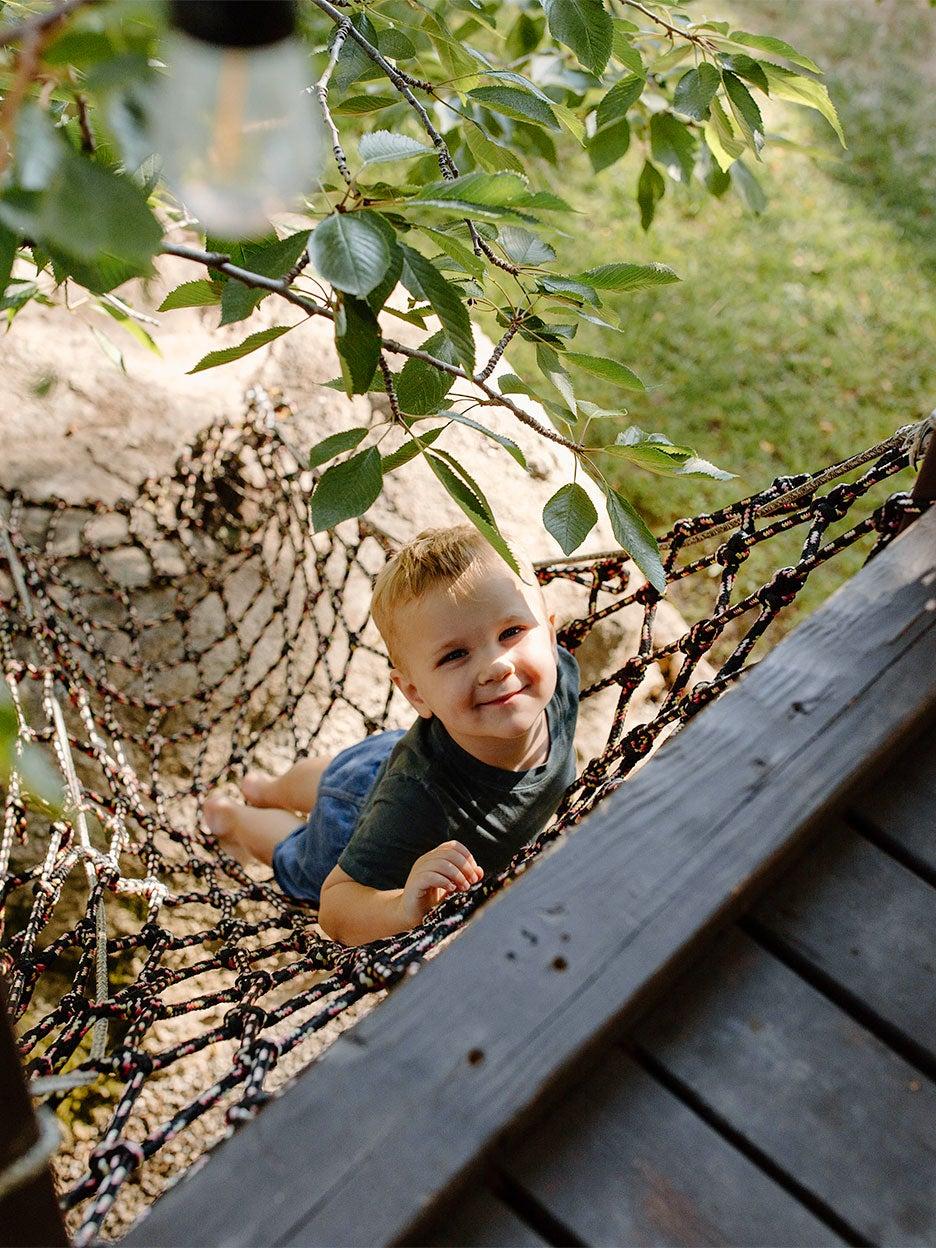 boy climbing net