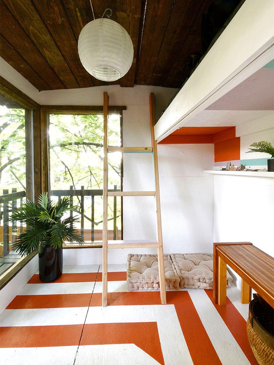 mod treehosue with orange and white floors