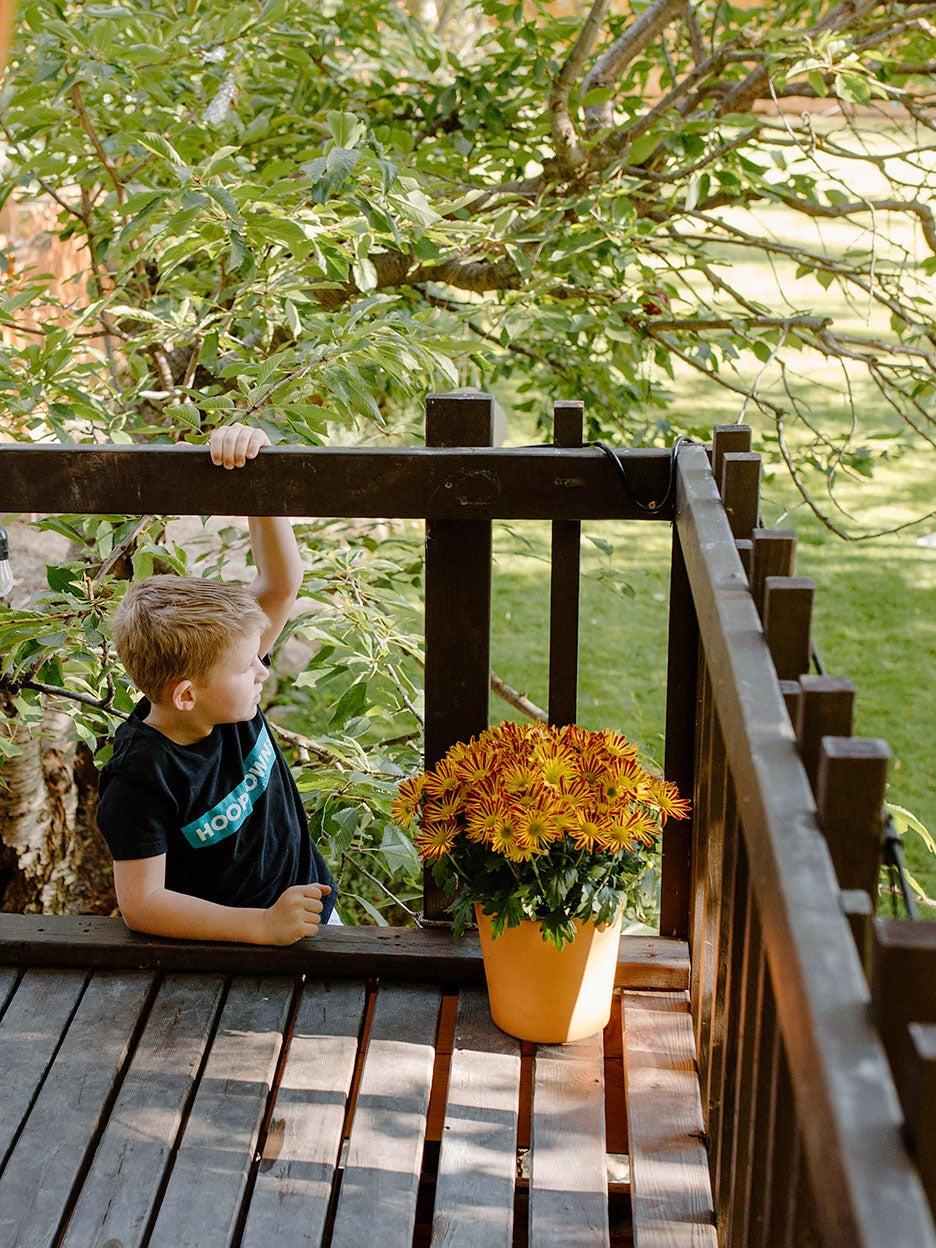 boy climbing up to deck