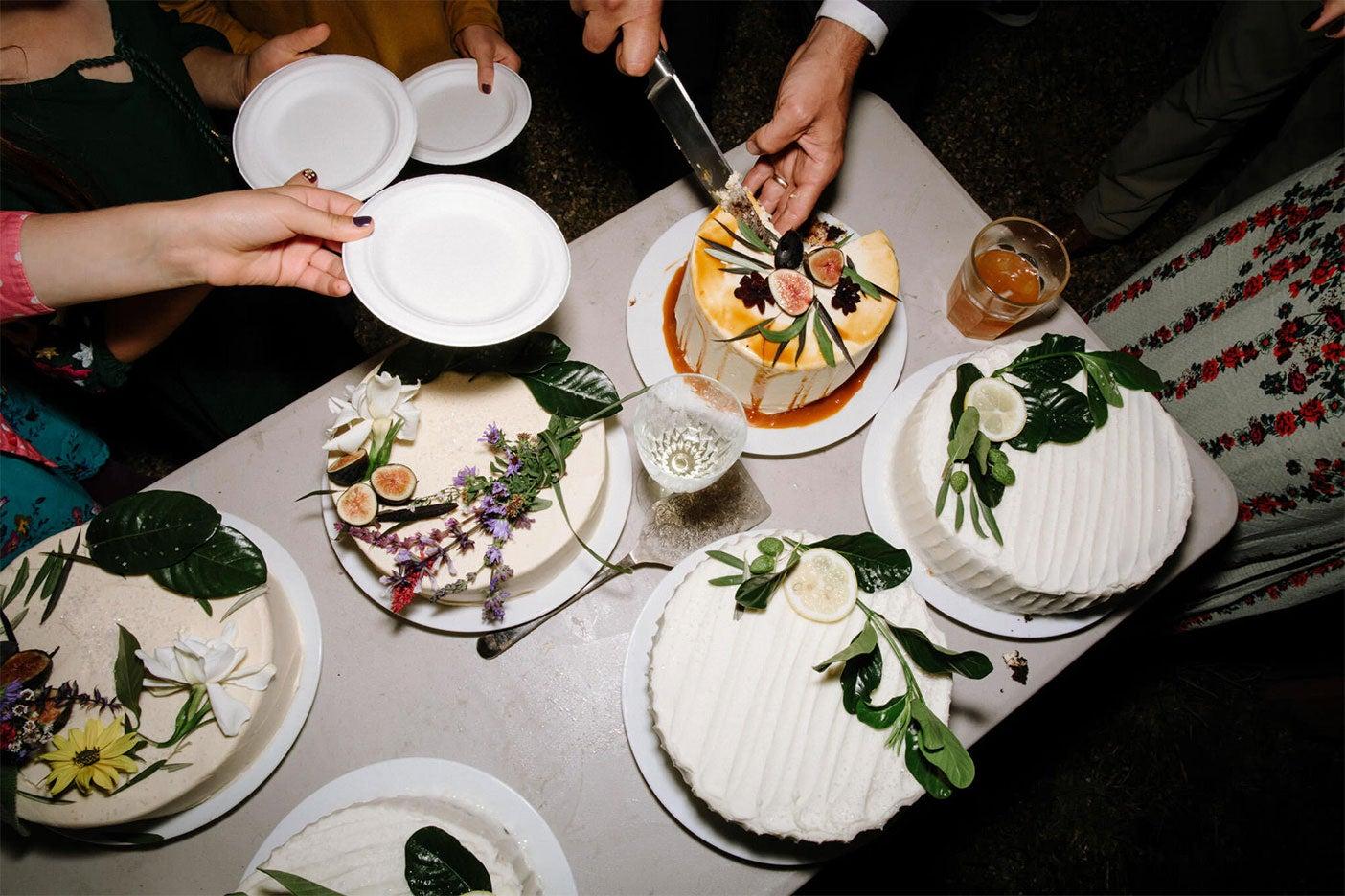 wedding cakes being cut