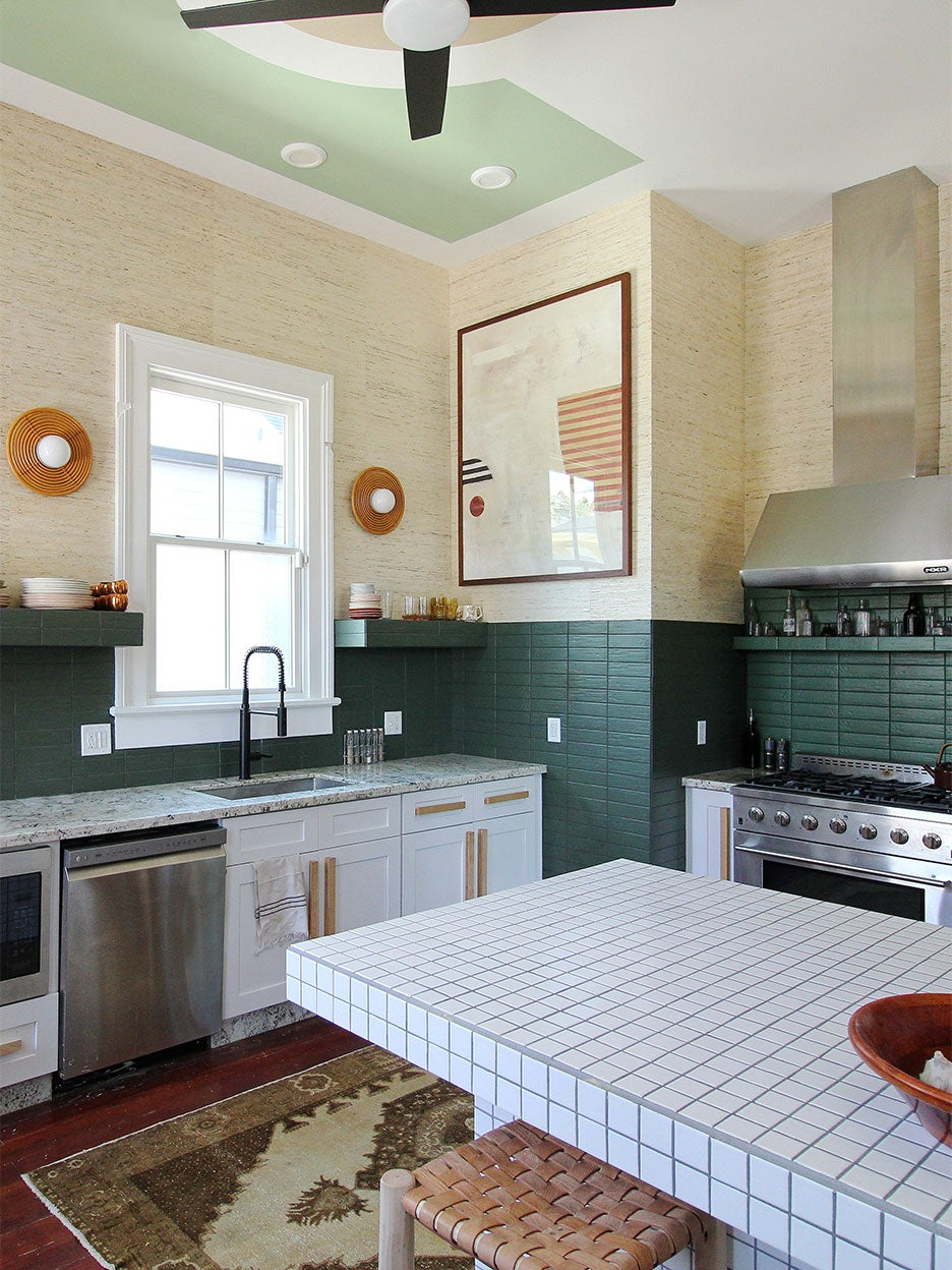 Kitchen with green tile and grasscloth wallpaper