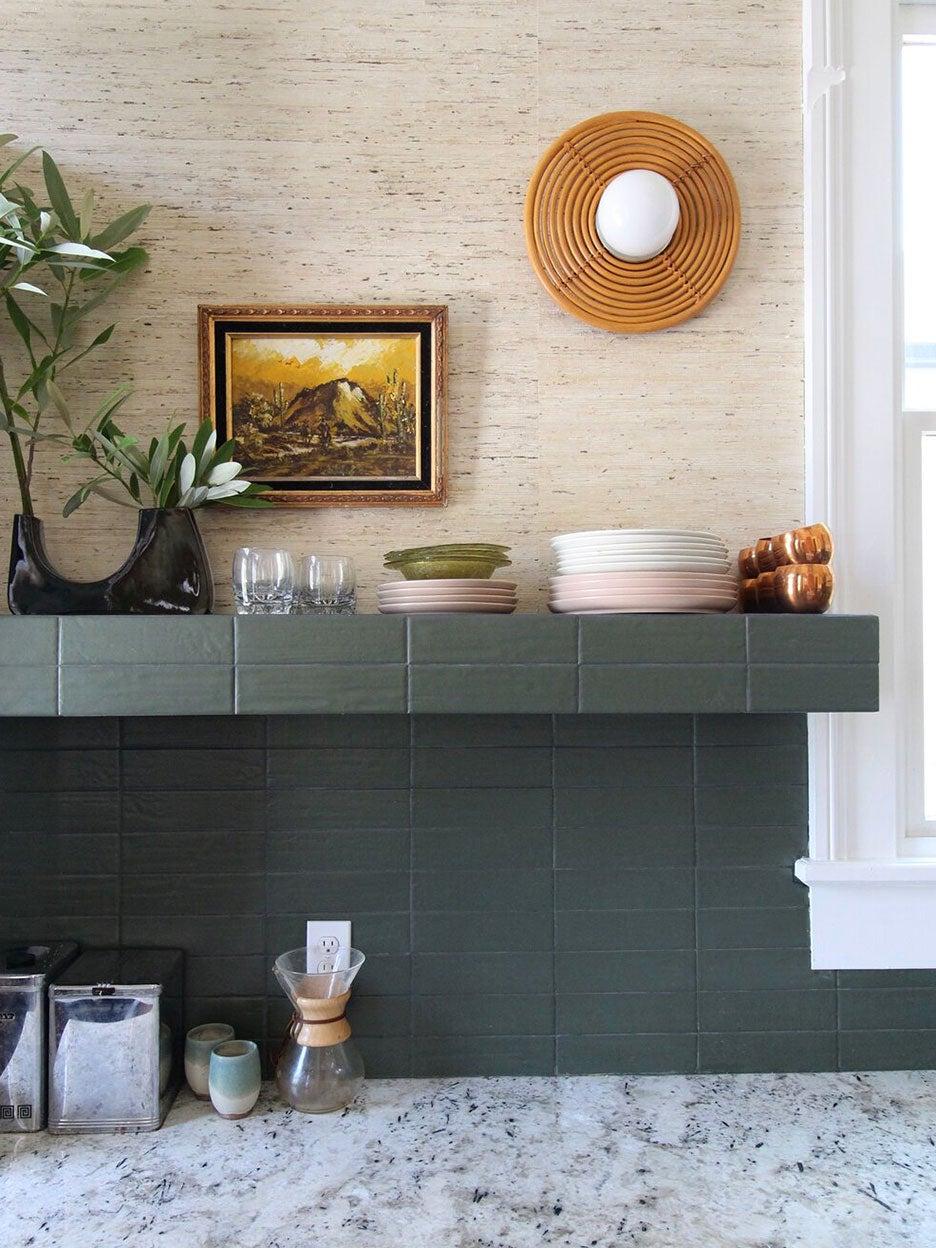Green tiled open shelf above countertops