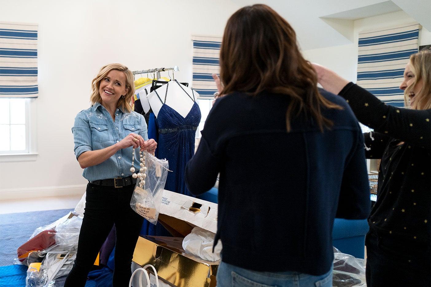 women sortign clothes
