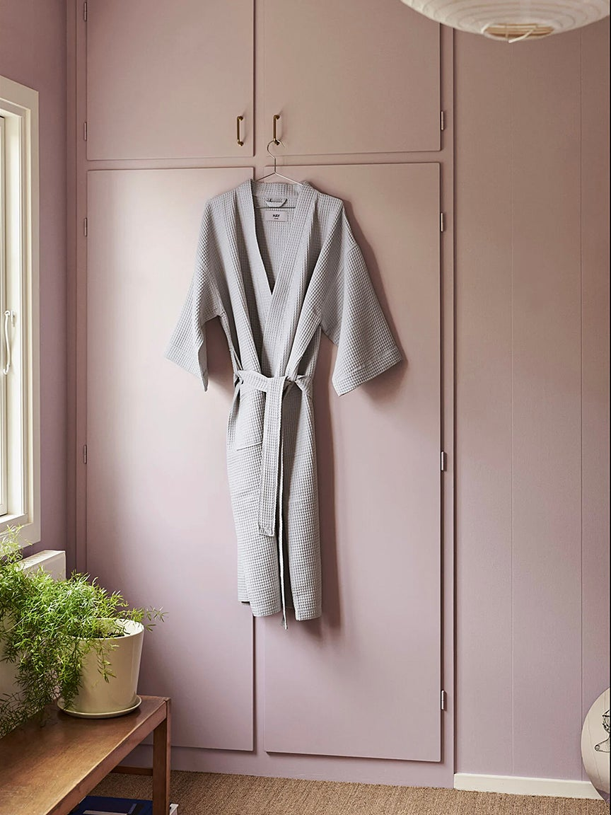 bathrobe hanging in front of a pink closet