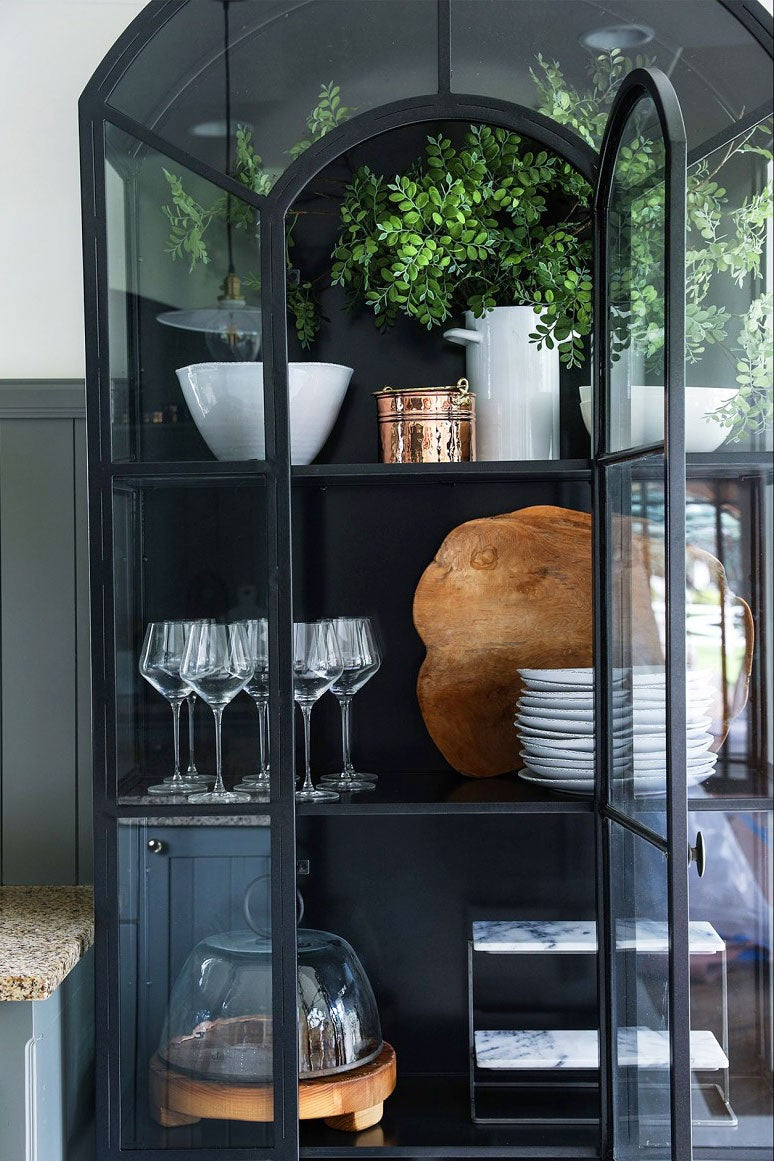 black cabinet with glass doors