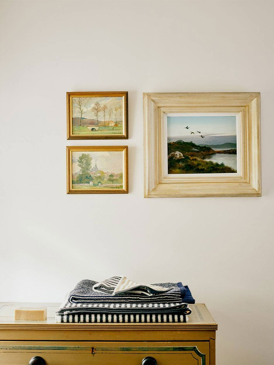vignette with picture frames hanging on wall