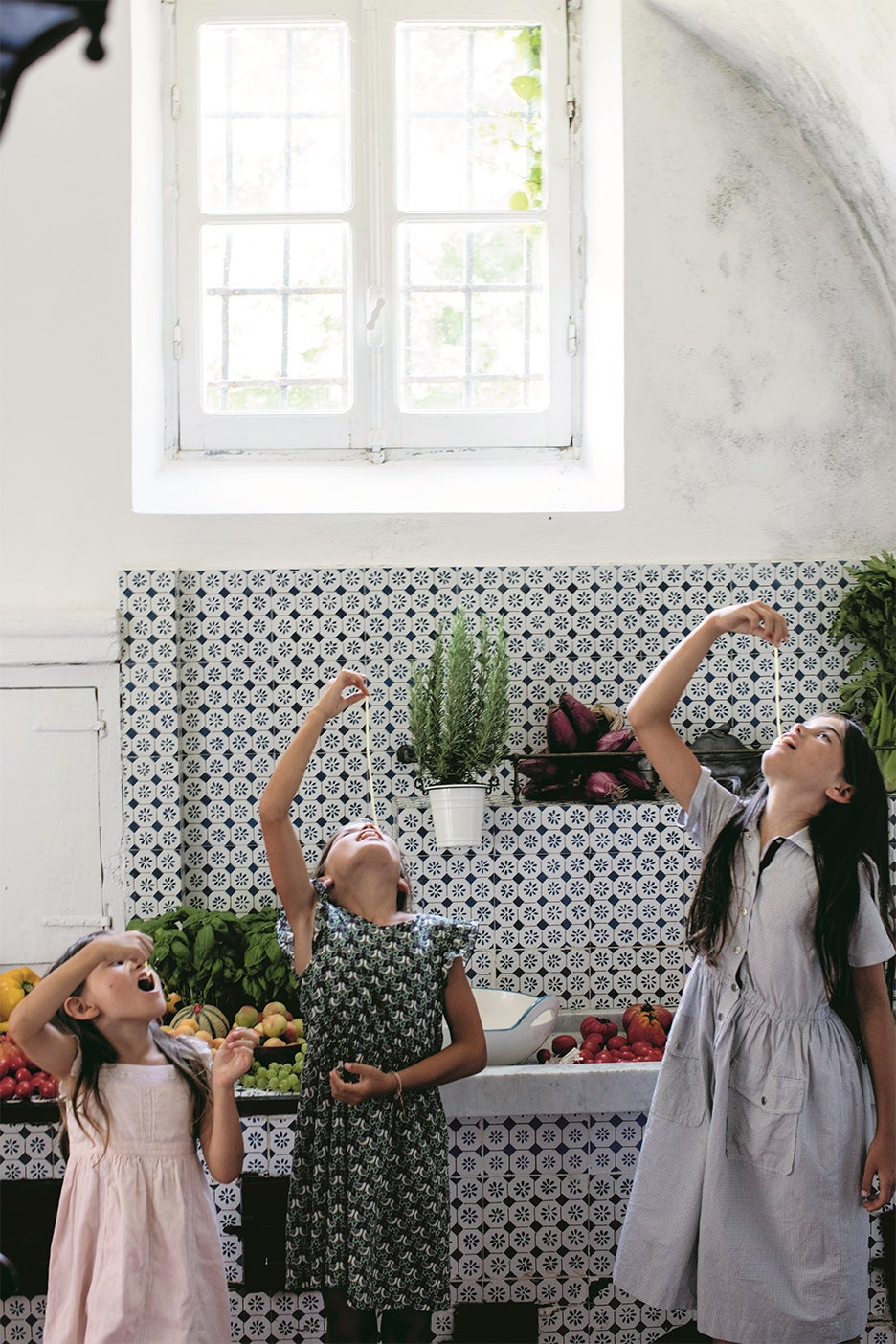 kids in kitchen eating pasta