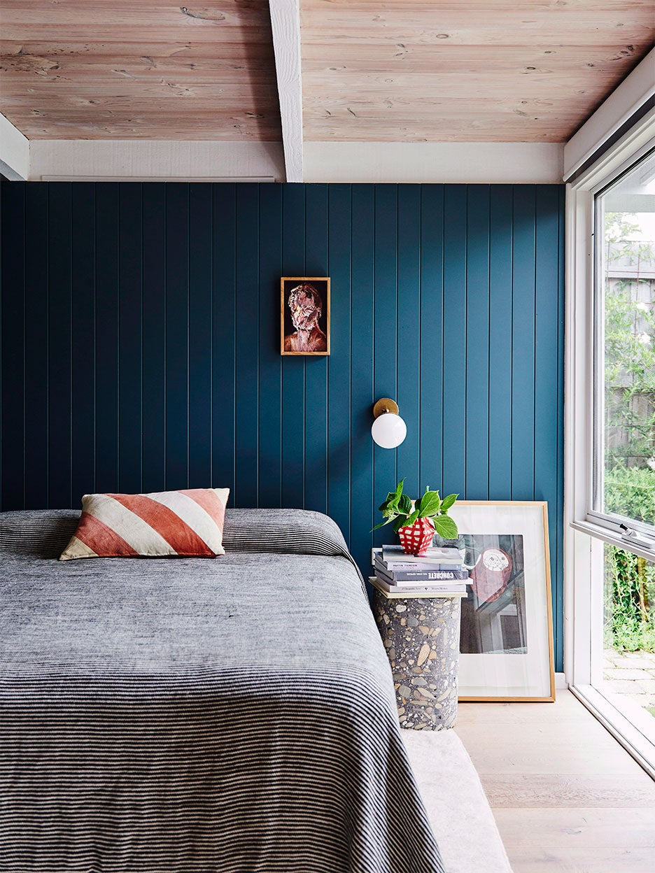 Teal blue bedroom with concrete table