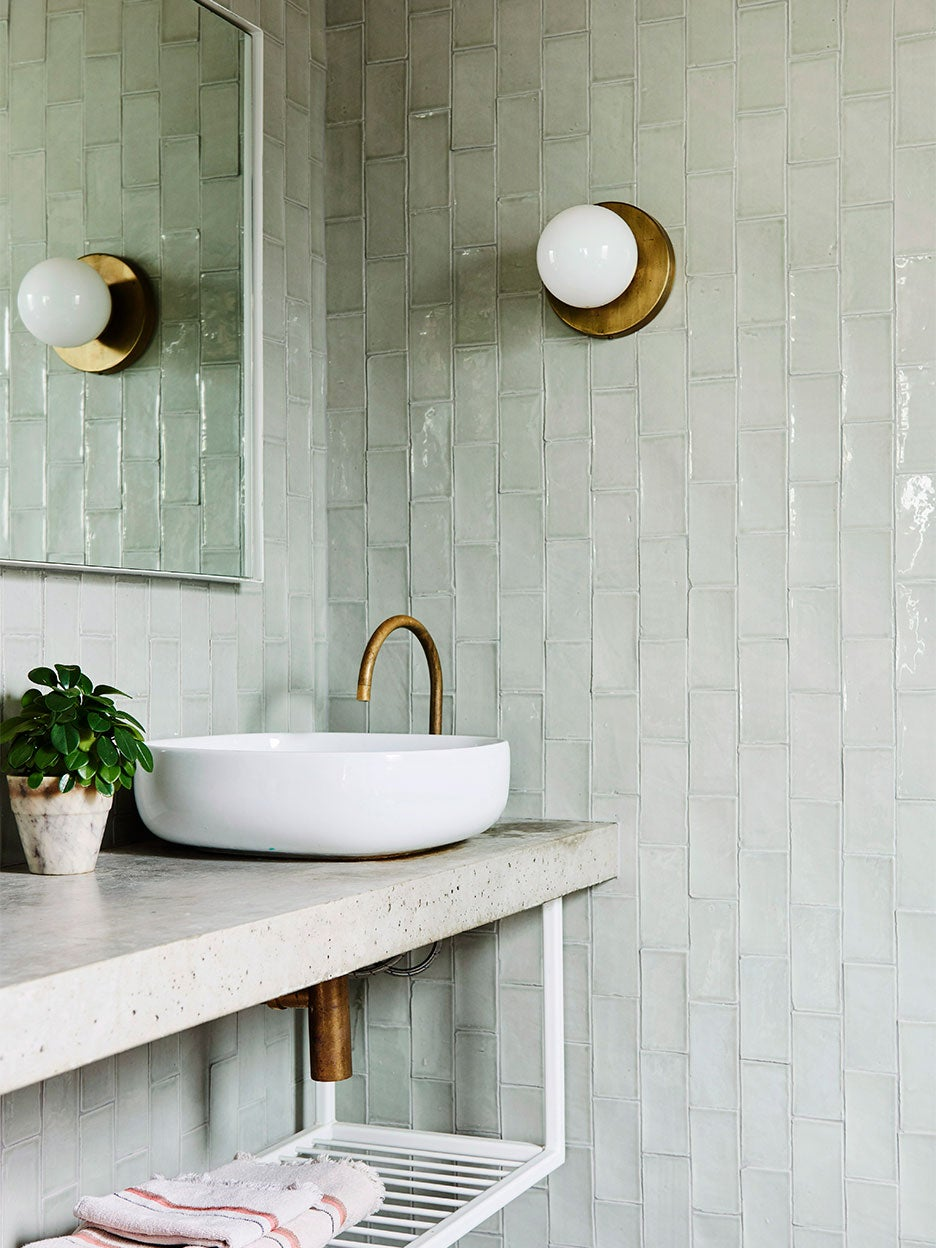 Green tiled bathroom with concrete countertop