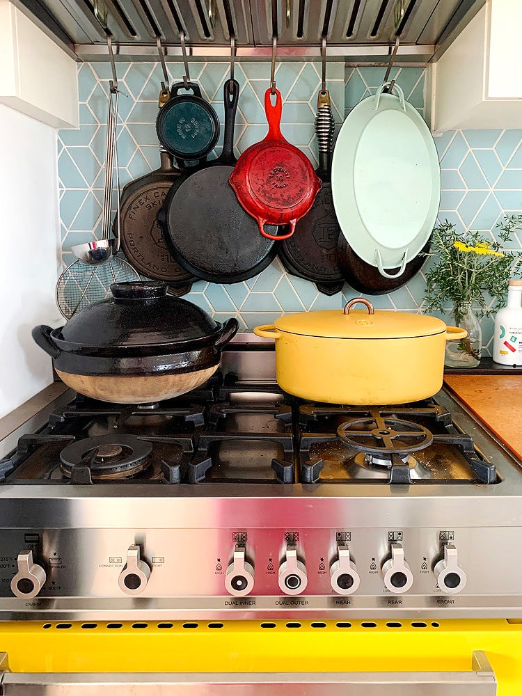 pots hanging over stovetop