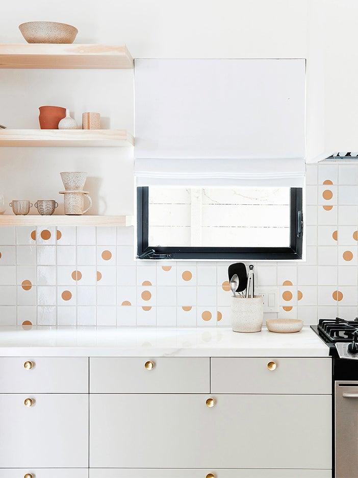 white kitchen wiht fun backsplash