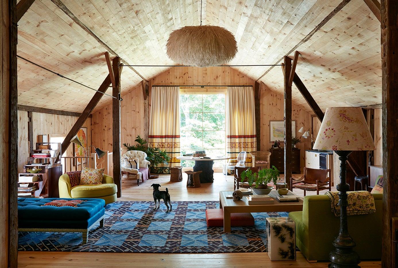 Wood-paneled room with blue Swedish rug