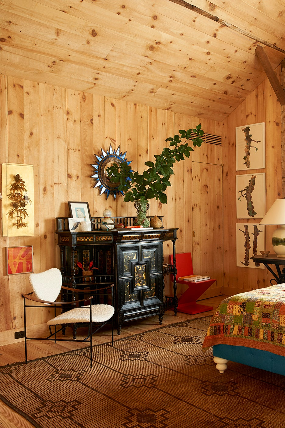 Wood-paneled bedroom with antiques