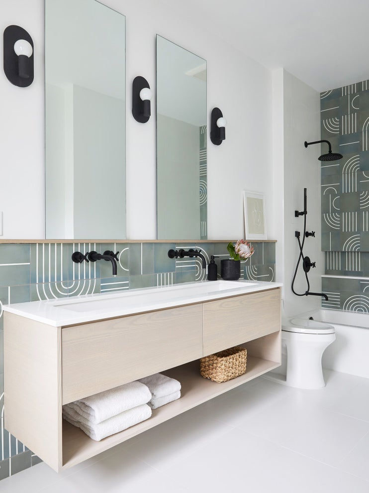 bathroom with pale wood vanity and grey abstract printed tile
