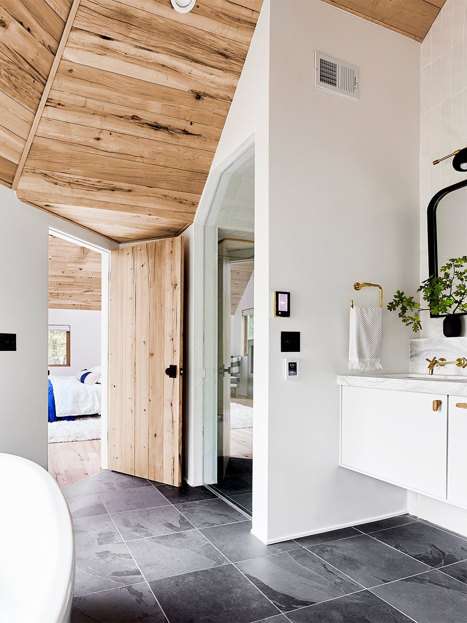 white bathroom with wood ceiling and large grey tile flooring