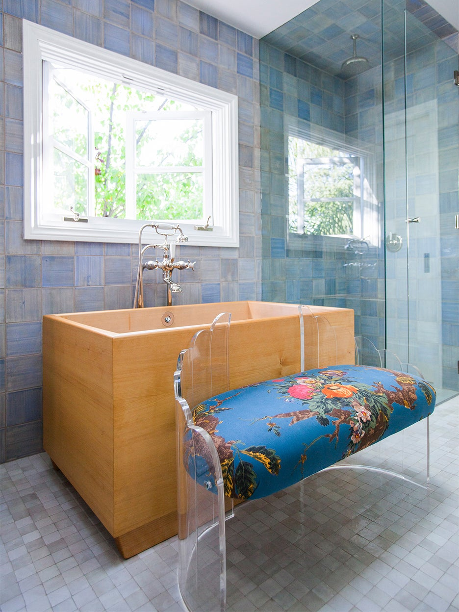 bathroom with wood tub and blue tile walls