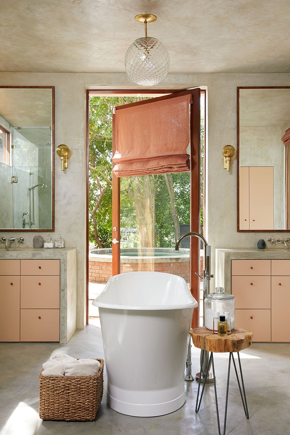 Concrete bathroom with blush curtains