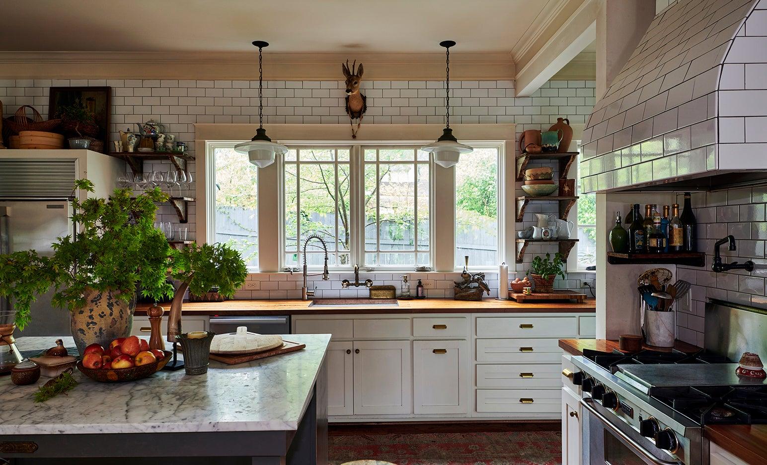 Kitchen with white subway tile walls
